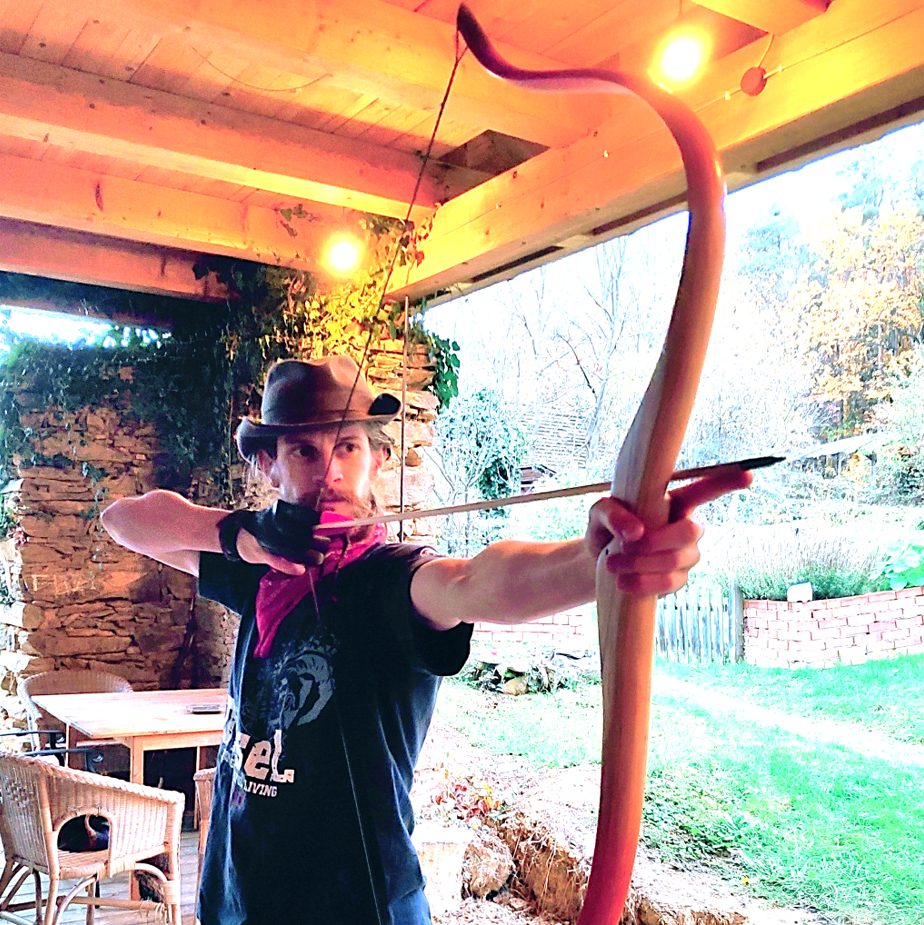 Charly firing a bow